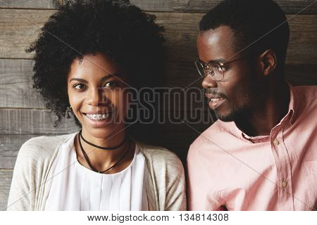 Close Up Shot Of Young African Couple: Beautiful Girl With Afro Hairstyle And Braces Looking And Smi