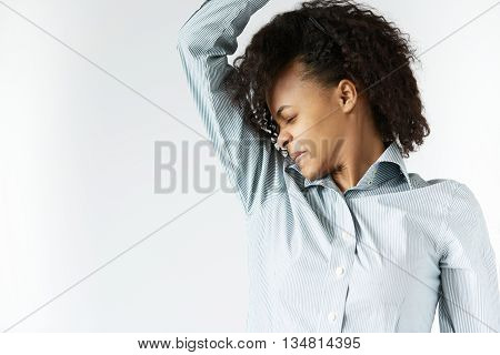 Bad Smelling Concept. Profile Portrait Of African Woman In Striped Shirt With Black Afro Hairstyle,