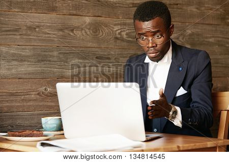 Computer Keeps Freezing! Human Face Expressions And Emotions. Shocked African American Businessman L