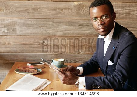 Handsome African Man With Short Haircut And Moustache, In Dark Blue Formal Suit, Wearing Watches And
