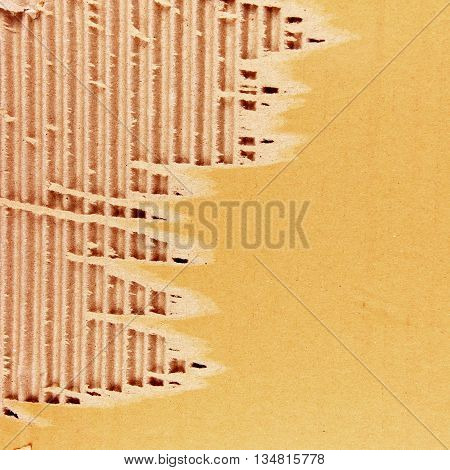 The brown corrugated cardboard sheet background or texture