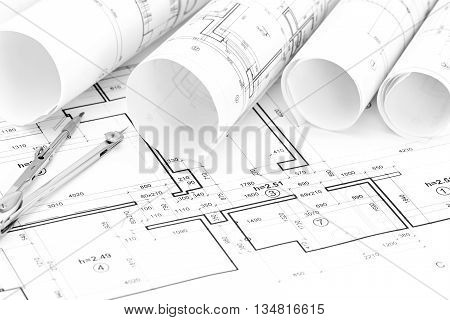 Architectural Background With Plan, Blueprints Rolls And Drawing Compass
