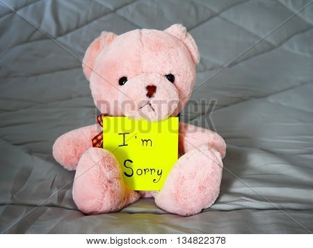 I'm sorry on post note with teddy doll on bed