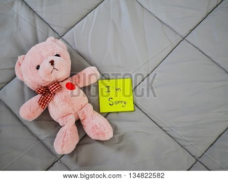 I'm sorry on post it with teddy doll on bed
