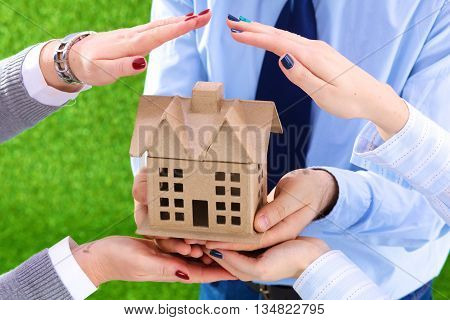 A small house in the hands. Big plans for the future.