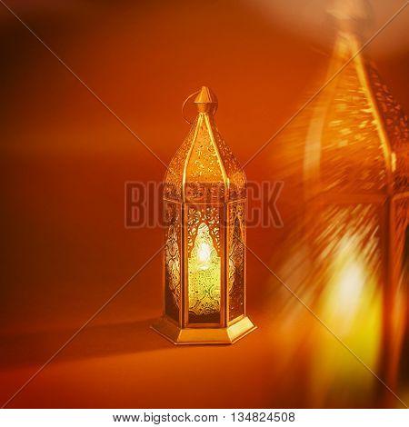 An abstract image of decorative Ramadan lantern.'Ramadan Kareem'. Greeting card cover.
