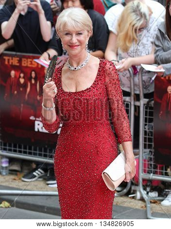 LONDON, UK, JULY 22, 2013: Dame Helen Mirren attends the European Premiere of Red 2 at Empire Leicester Square picture taken from the street