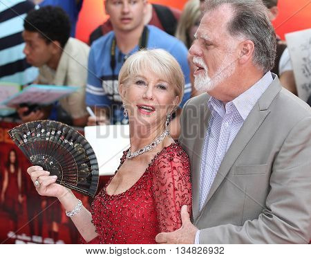 LONDON, UK, JUL 22, 2013: Dame Helen Mirren attends the European Premiere of Red 2 picture taken from the street