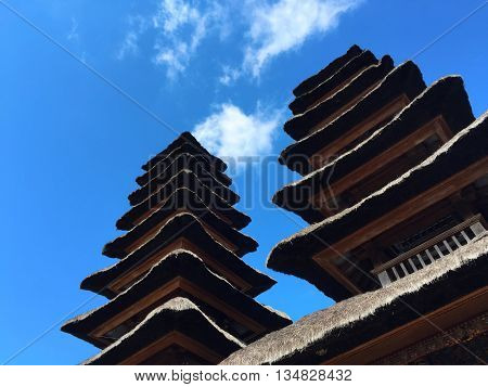 The roofs of religious buildings, pagoda roof of balinese temple, dry palm leaf roof of balinese temple