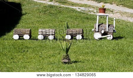 picture of a cute firewood train on a grass. decoration of a backyard