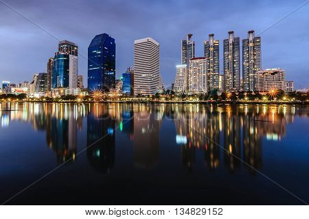 Thailand, Bangkok - September 6, 2014 : Lake at the night Benchakitti Park in Bangkok. Benjakiti Park is a park in honor of Her Majesty Queen Sirikit, is located in the factory area.night shoot.