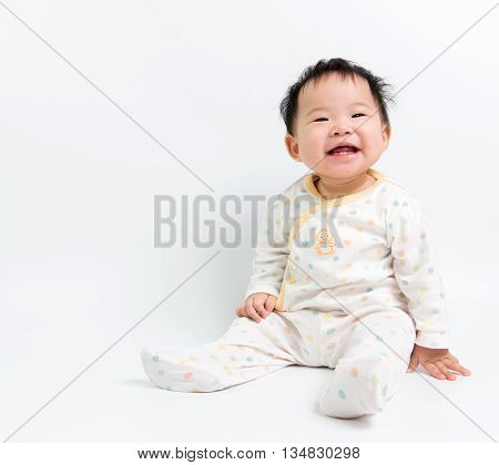 Portrait of Asian baby girl sitting over white background