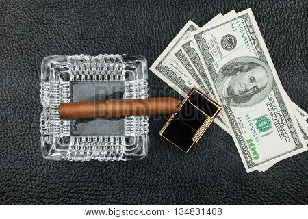 Cigar ashtray lighter money on genuine leather can be used as background