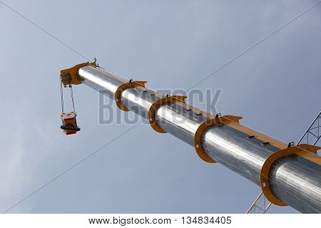metal hook of a crane against the sky