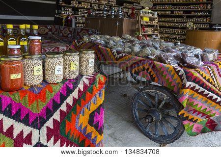 MUGLA, TURKEY - APRIL 26, 2016: Organic food market with legumes in the jars, in Mugla, Turkey