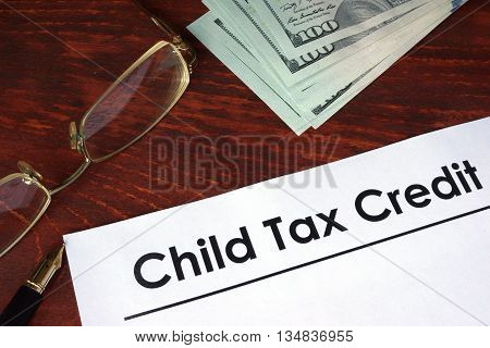 Child tax credit written on a paper. Financial concept.