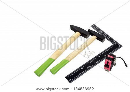 Two hammer, square tool and roulette on a white background