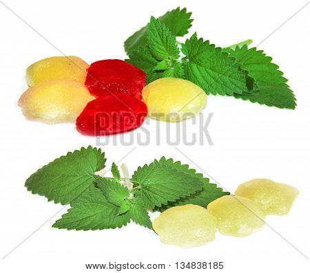 frozen fruit berry red ice cubes isolated on white background. Feminine beauty and cosmetics concept a sprig of lemon balm lemon juice frozen yellow cranberry juice