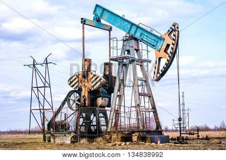 Oil pump. Oil industry equipment. Oil pumpjack or nodding horse pumping unit