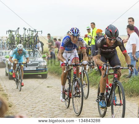 Quievy, France - July 07 2015: The French cyclist Matthieu Ladagnous of FDJ Team riding in the peloton on a cobblestone road during the stage 4 of Le Tour de France 2015 in Quievy France on 07 July2015.