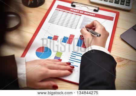 Businesswoman Checks Start Up Report