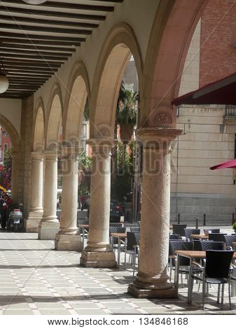 Arched passageway and sidewalk cafe in the historic centre of Jaen Andalusia Spain