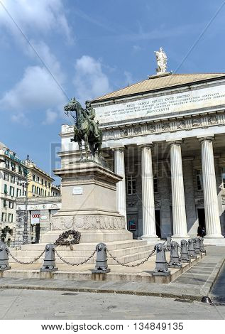 Genova Italy - September 27 2015: Statue of Giuseppe Garibaldi - italian General and politician on pedestal in front of opera house (Teatro Carlo Felice) on Piazza De Ferrari in Genoa Italy
