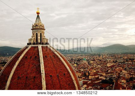 The Basilica di Santa Maria del Fiore. Aged photo. Florence's Cathedral Dome. Retro filter. City view and Firenze Duomo Cupola. Vintage colors. Florence Tuscany Italy.