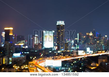 Night blurred bokeh lights city and road, abstract background