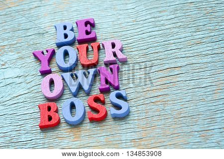 Be Your Own Boss Phrase On Vintage Wooden Background