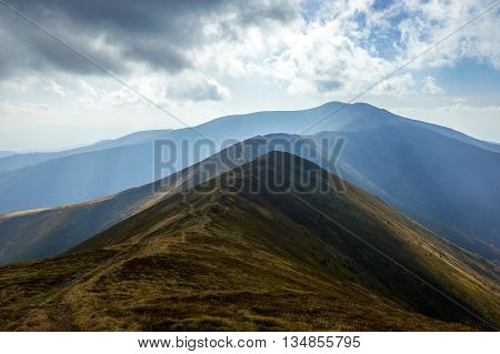 The mystical landscape of dark harsh Carpathian Mountains