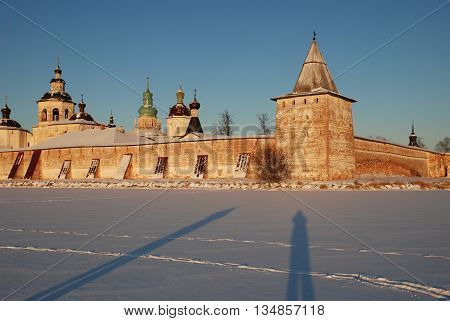 Photo of the Kirillo-Belozersky monastery in a winter landscape at sunset. Vologda region Russia.