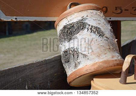 Mug with a lid made of birch bark in the outside shop