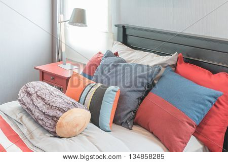 Colorful Pillows On Bed In Single Bedroom Design