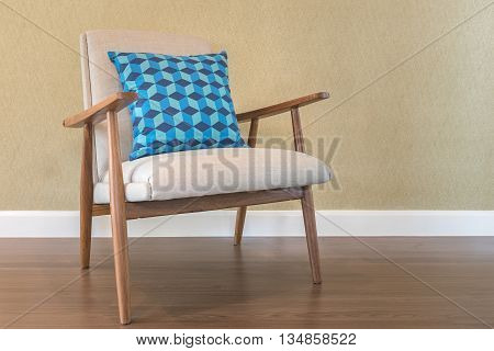 Blue Pillow On Wooden Chair With Green Wall