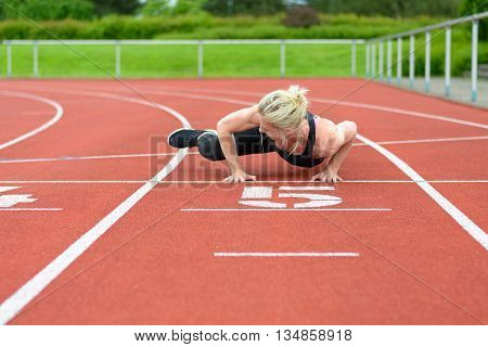 Athletic Woman Warming Up Hip Muscles At Track