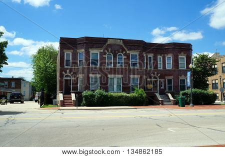 JOLIET, ILLINOIS / UNITED STATES - JUNE 1, 2015: The Stern Building is an historic brick apartment building in downtown Joliet.