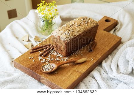 background of bread and other bakery product. Composition of bread on a white drapery background. bread from wholemeal flour.