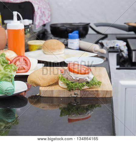 decorated Hamburger before served / Cooking Hamburger concept