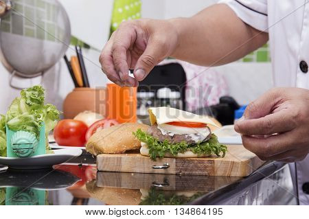Chef cooking and decorated Hamburger /Cooking Hamburger concept
