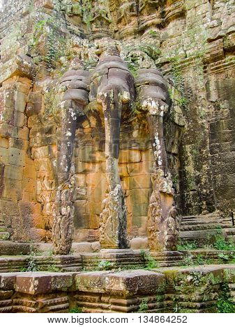 Temple detail at Angkor Thom showing stone carved sculptures