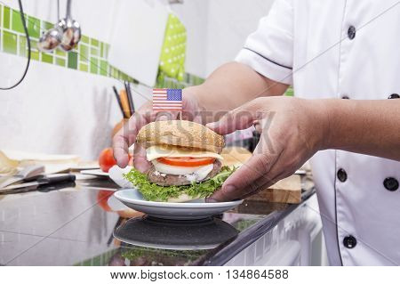 Chef cooking and decorated Hamburger with American Flag /Cooking Hamburger concept