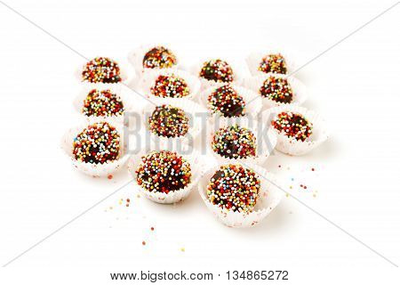 Chocolate flavored balls isolated on white background