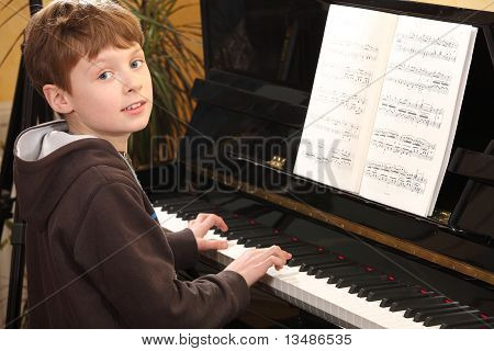 Teenage Boy Plays Piano