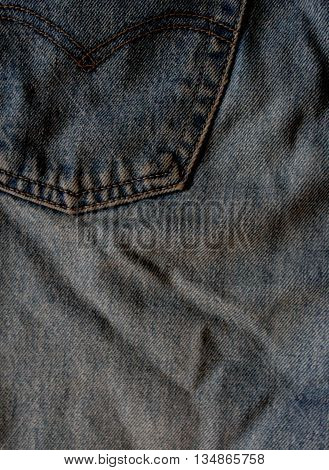 Blue jeans macro. Jeans fabric texture. Seam on jeans.