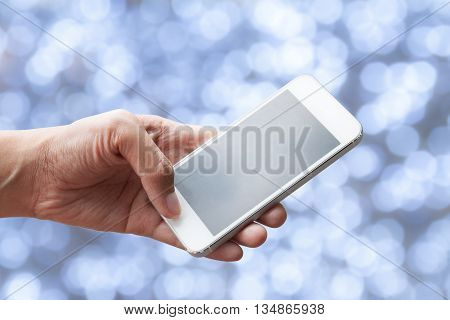 Close up of a woman using mobile smart phone with bokeh background
