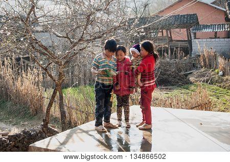 HA GIANG, VIETNAM, February 16, 2016 Children's groups, ethnic Hmong, Ha Giang mountainous region. revise outdoor, spring