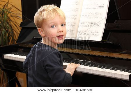 Young Boy Plays Piano