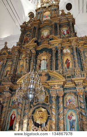 beautiful iconostasis with ancient icons set in wooden frame. Religious work of art in the church