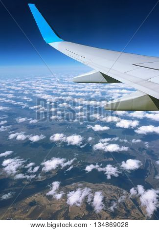 Aircraft wing and clouds, Wing aircraft in altitude during flight